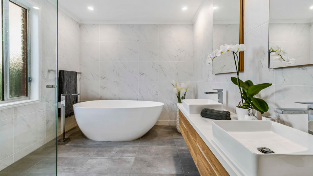 bathroom remodeled with cool grey tones